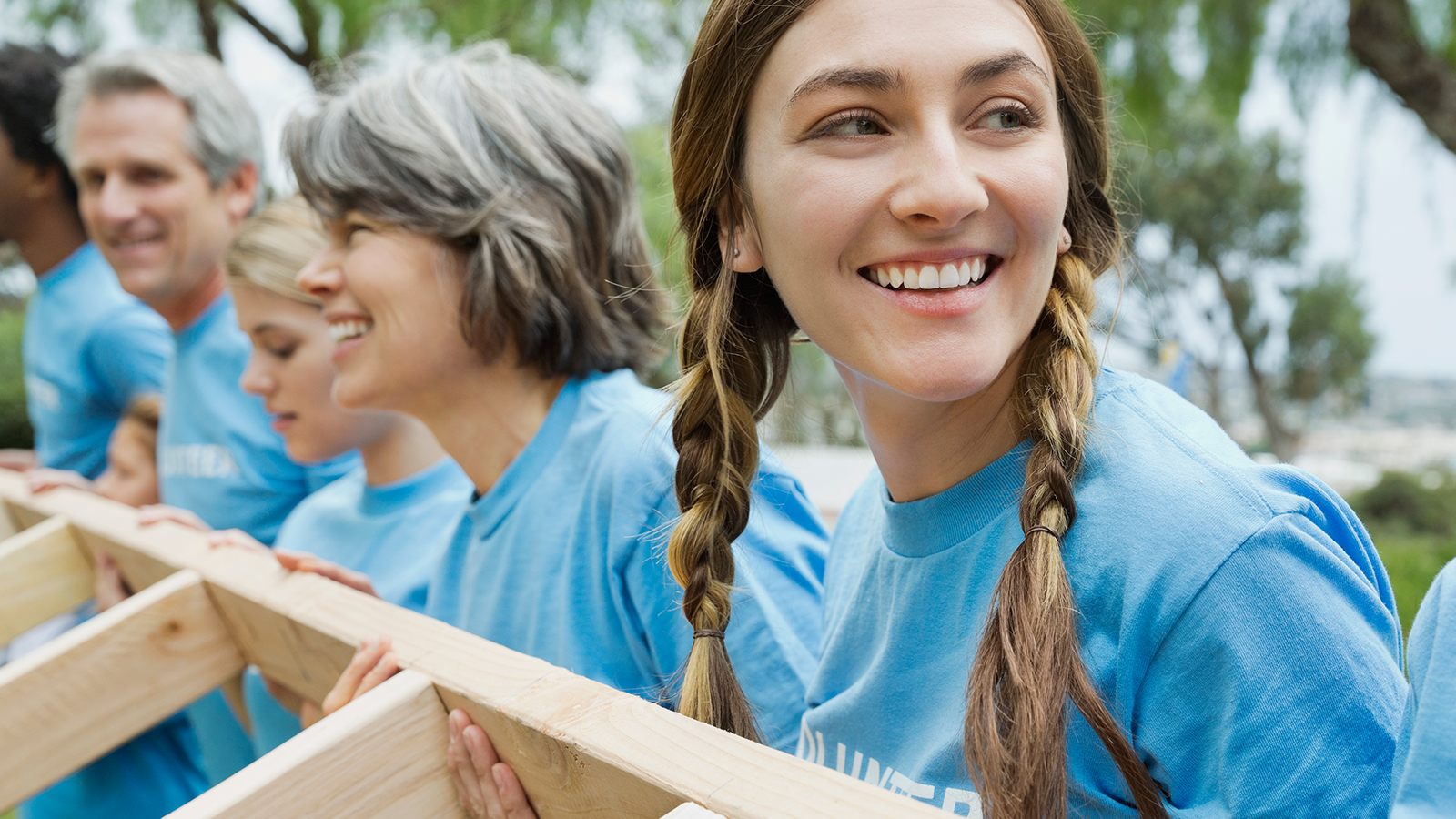 Visa volunteers working at a build site.