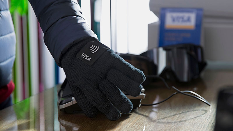 An olympic athlete wearing and promoting a Visa wearables glove with pin for easy checkout.